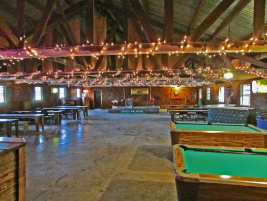 Large dance hall with stage, two bars, two pool tables, ample seating with tables. Image by Cami Perriraz