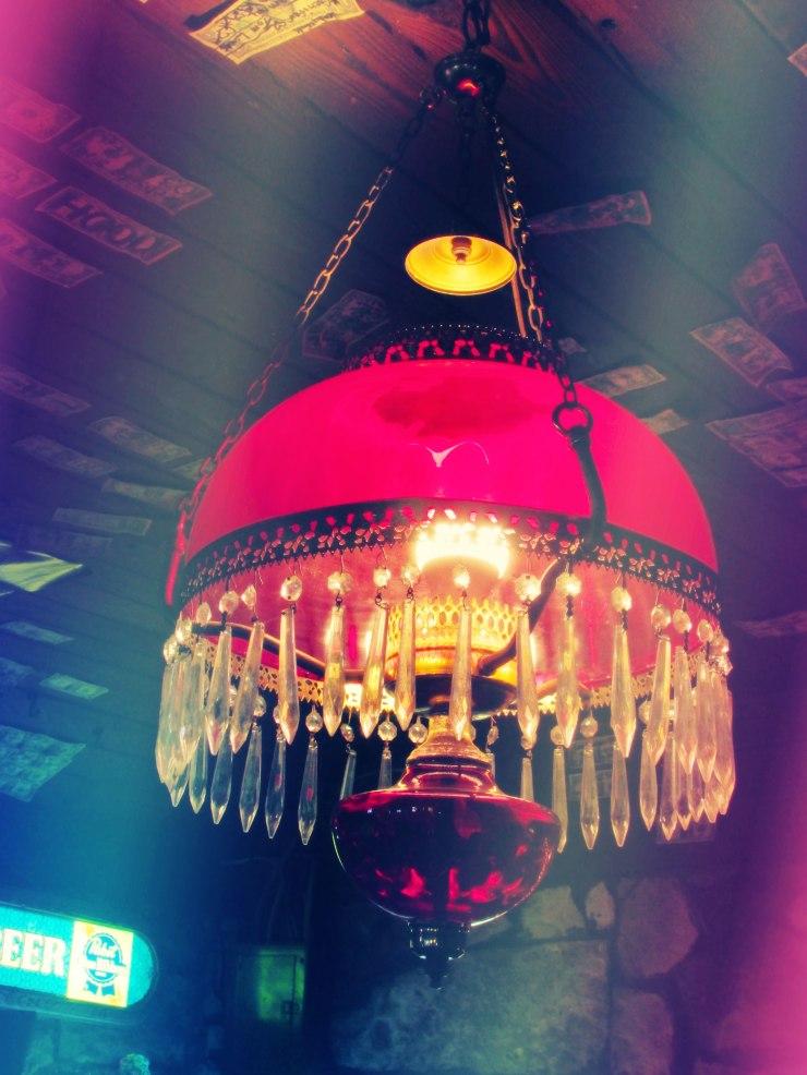 Red antique chandelier from Devil's Backbone Tavern in Fischer, TX