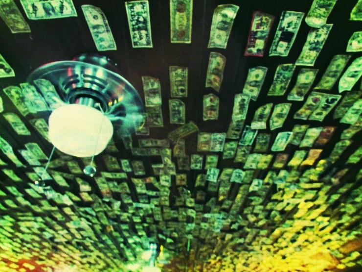 Dollar bills lining the walls of Devil's Backbone Tavern, Fischer, TX Image by Cami Perriraz